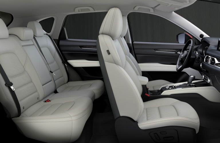 2018 Mazda CX-5 interior side shot of 2-row seating upholstery and dashboard