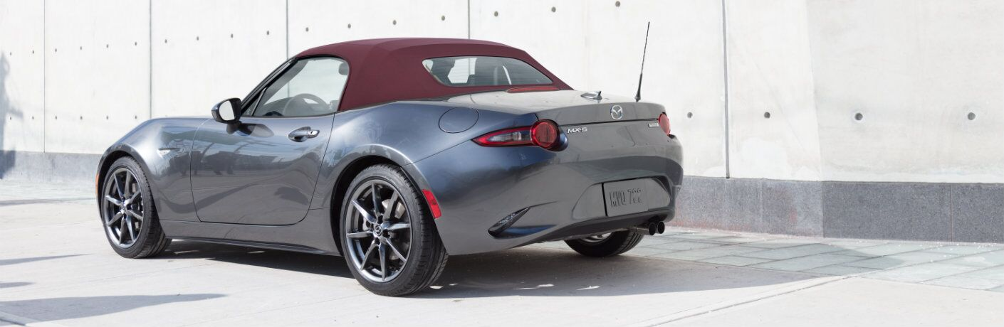 2018 Mazda MX-5 Miata soft top roadster exterior shot rear trunk and bumper parked in bright sunlight