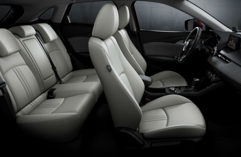 2019 Mazda CX-3 interior side shot of seating rows and upholstery