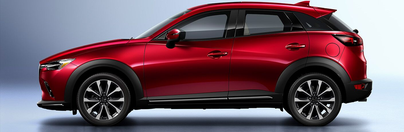 2019 Mazda CX-3 exterior side shot of red paint coat in a blank showcase room