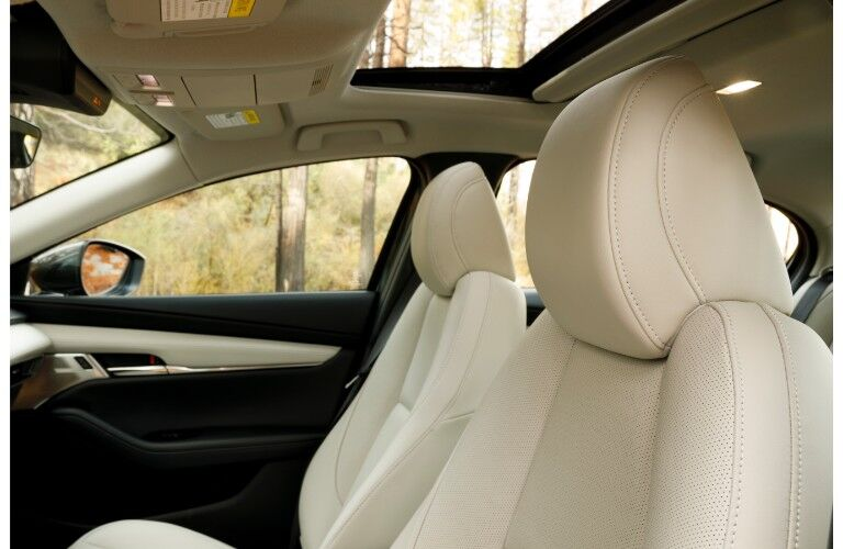 2019 Mazda3 sedan interior side shot of front seating upholstery and sunroof