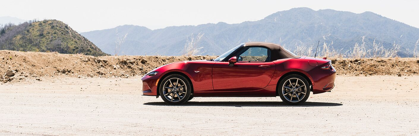 2019 Mazda MX-5 Miata exterior side shot red paint job parked in a desert clearing