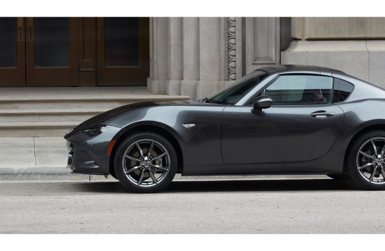 2019 Mazda MX-5 Miata RF exterior side shot with gray metallic paint color parked outside marble stone steps