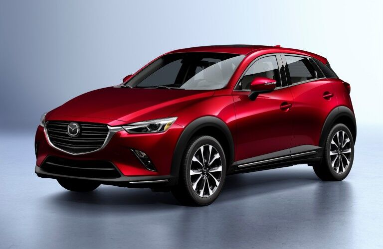 The front and side view of a red 2020 Mazda CX-3.