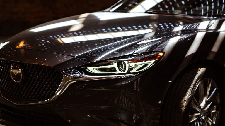 2020 Mazda6 sedan exterior closeup shot of headlight and grille design