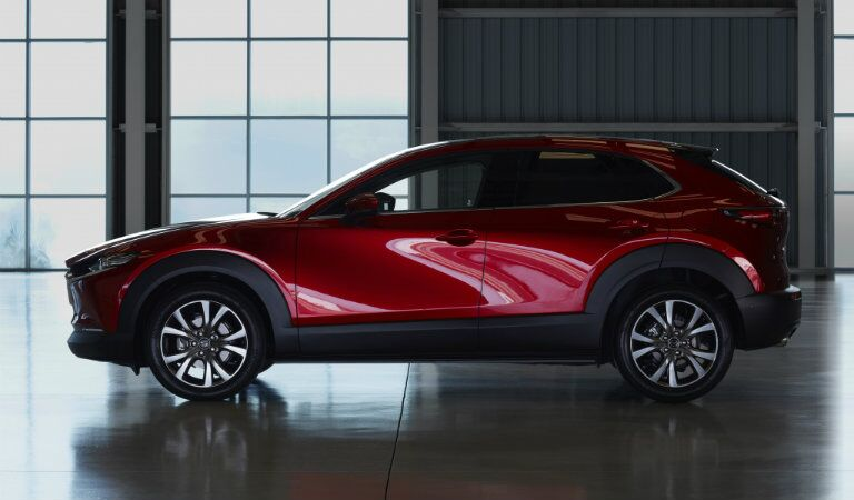 2020 Mazda CX-30 exterior side shot parked in a dark garage hangar