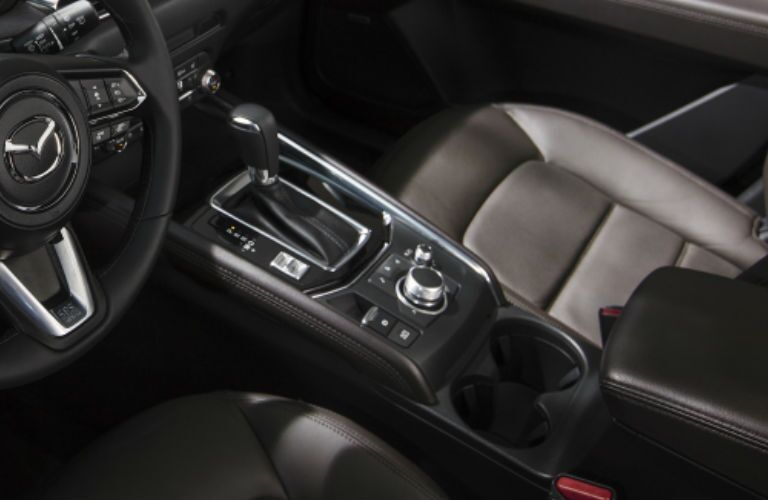 The front interior view of the shift knob inside the 2021 Mazda CX-5.