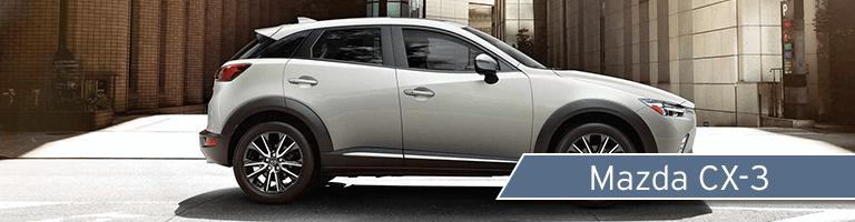 Mazda CX-3 side shot parked on city street