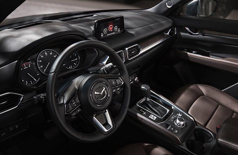 The front interior of a gray 2020 Mazda CX-5.