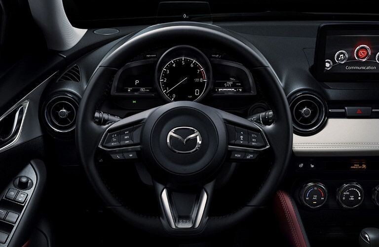 2018 Mazda CX-3 interior driver's view closeup of steering wheel and infotainment MAZDA CONNECT screen