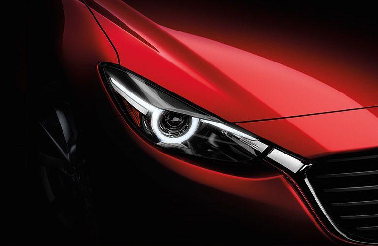 2018 Mazda3 hatchback 5-door exterior close up of red paint hood and headlight