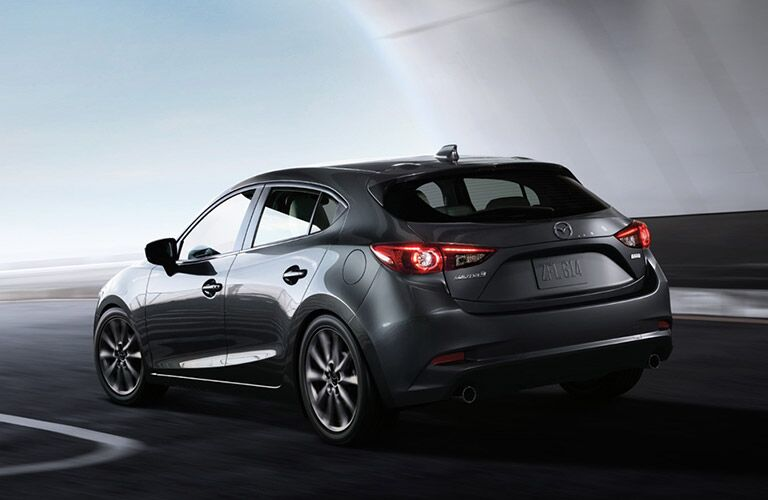 2018 Mazda3 hatchback 5-door exterior shot gray of rear trunk, liftgate, bumper and taillights