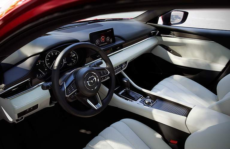 2018 Mazda6 interior outside angle shot of front seating upholstery, dashboard, and steering wheel