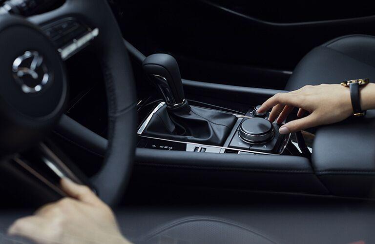 A front interior image of the center console inside a 2020 Mazda3 Sedan.