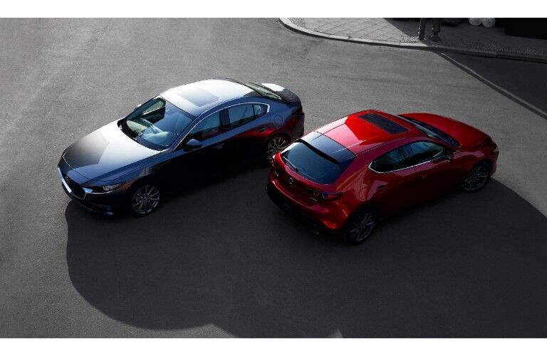 2019 Mazda3 sedan and hatchback models exterior overhead shot with gray and red paint colors