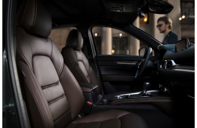 2019 Mazda CX-5 interior side shot of leather seating upholstery and interior accents
