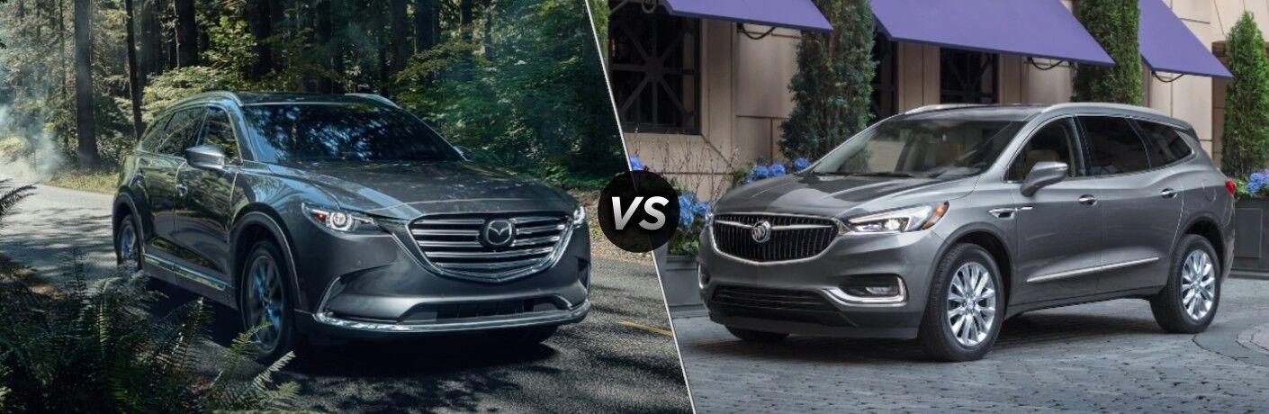 A dark gray 2020 Mazda CX-9 compared to a gray 2020 Buick Enclave.