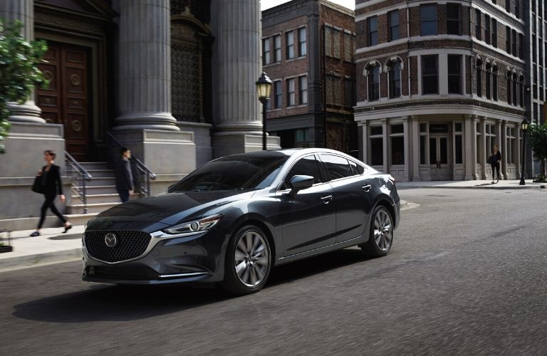 2020 Mazda6 driving though city from exterior front drivers side