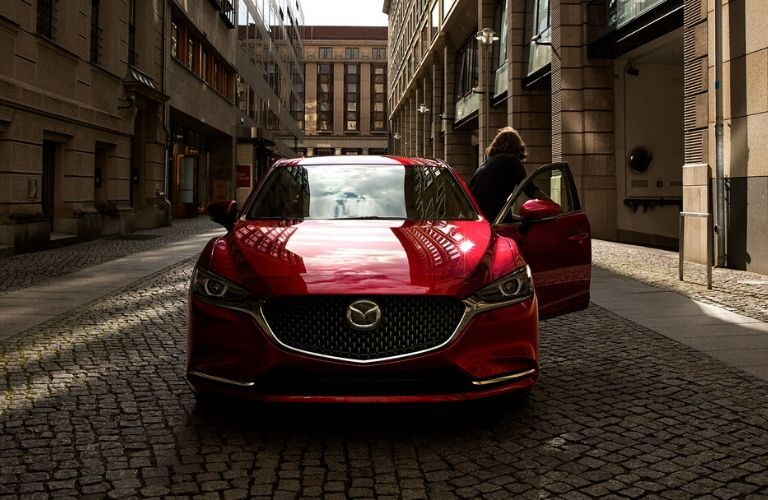 2020 Mazda6 from exterior front with driver exiting car