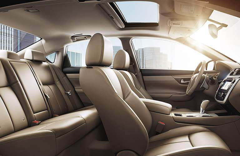 Seating in the 2018 Nissan Altima shown with both rows headroom and legroom and infotainment
