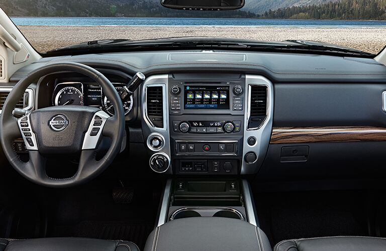 infotainment system in 2018 nissan titan with steering wheel and front dashboard