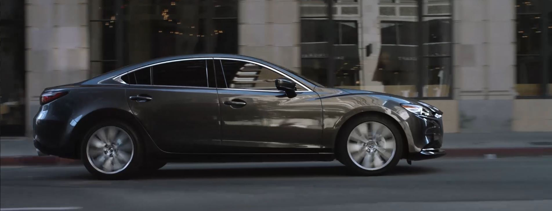 A 2020 Mazda6 driving on a city street