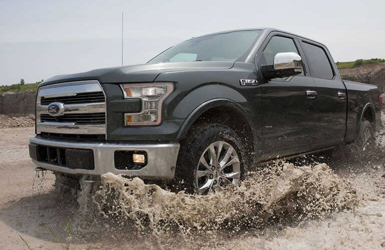2016 Ford F-150 driving through a river
