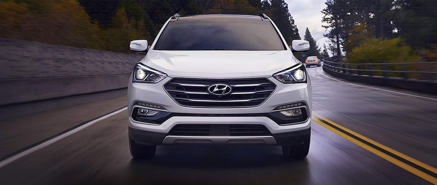 white 2017 Hyundai Santa Fe on the road