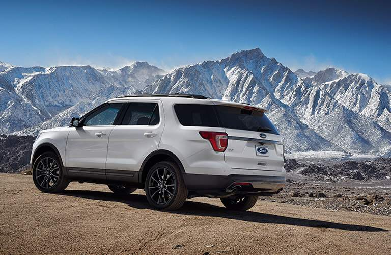 white 2017 Ford Explorer driving up a mountain range