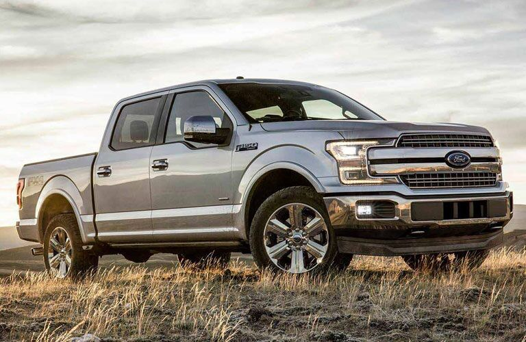Side view of a silver 2018 Ford F-150 parked in a field