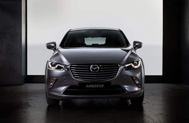 Front View of Dark Grey 2018 Mazda CX-3 in Front of a White Background
