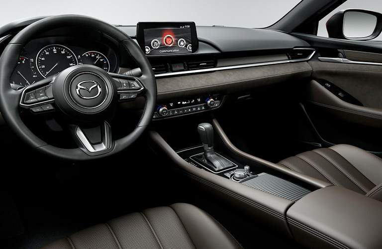 2018 Mazda6 interior shot of front seating, steering wheel, transmission, and dashboard design