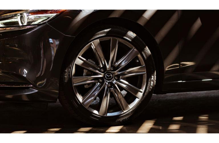 2019 Mazda6 sedan exterior closeup of alloy wheel design fit into tires
