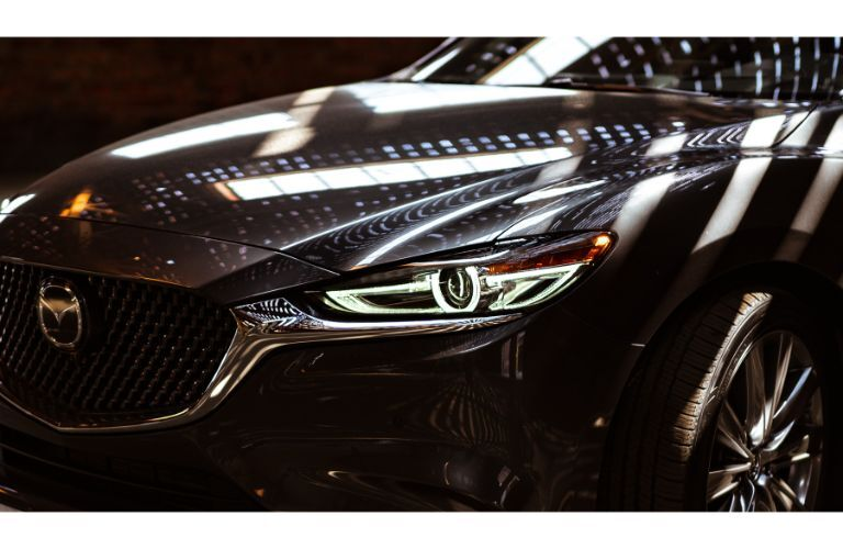 2019 Mazda6 sedan exterior closeup shot of headlight and grille design