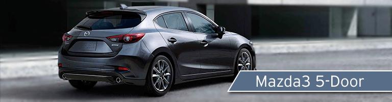 rear view of a silver Mazda3 5-Door & 2018 Mazda3 4-Door vs 2018 Mazda3 5-Door