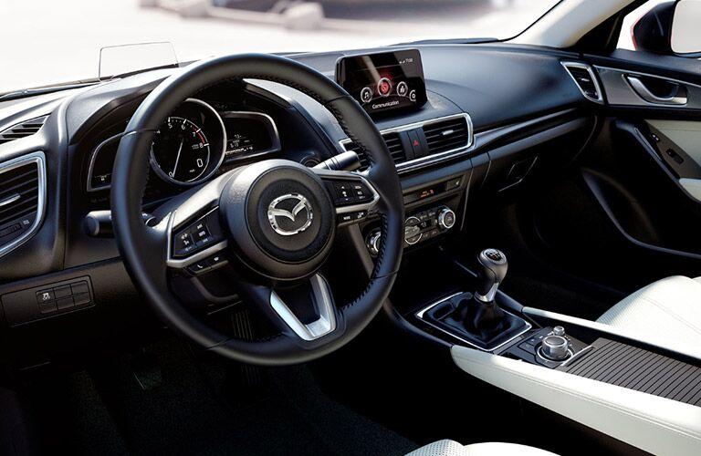 2018 mazda3 steering wheel and dashboard closeup