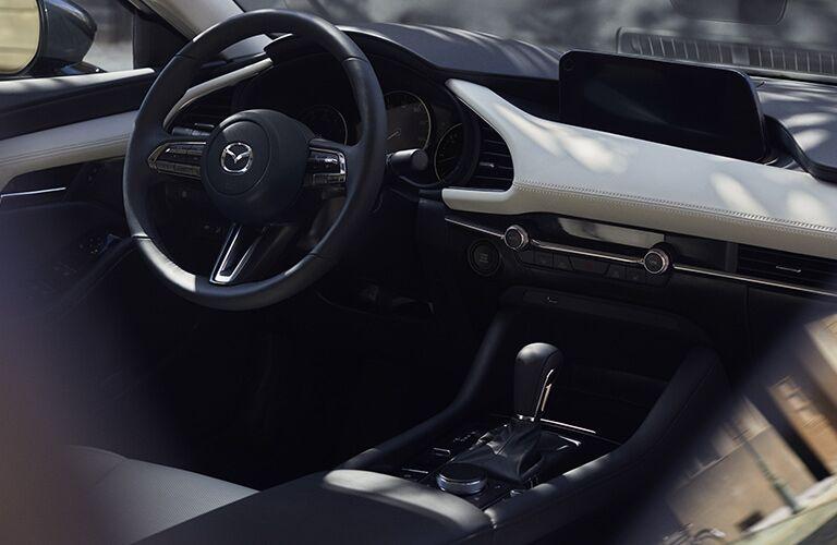 steering wheel and dash inside mazda3