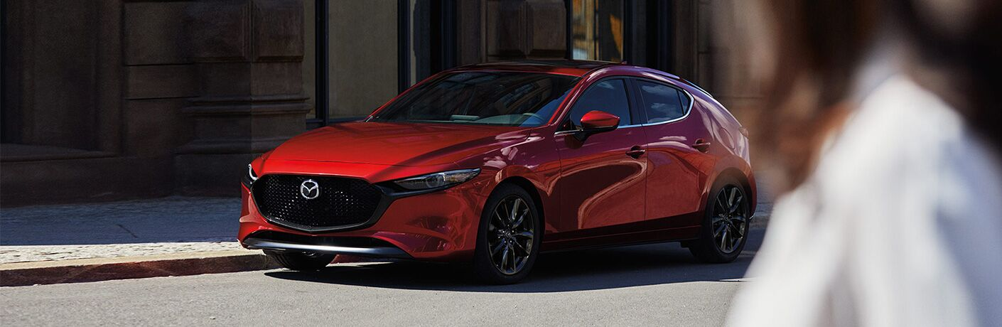 front view of red mazda3 hatchback