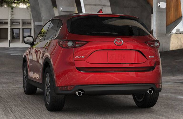Exterior view of the rear of a red 2018 Mazda CX-5 parked in a parking structure
