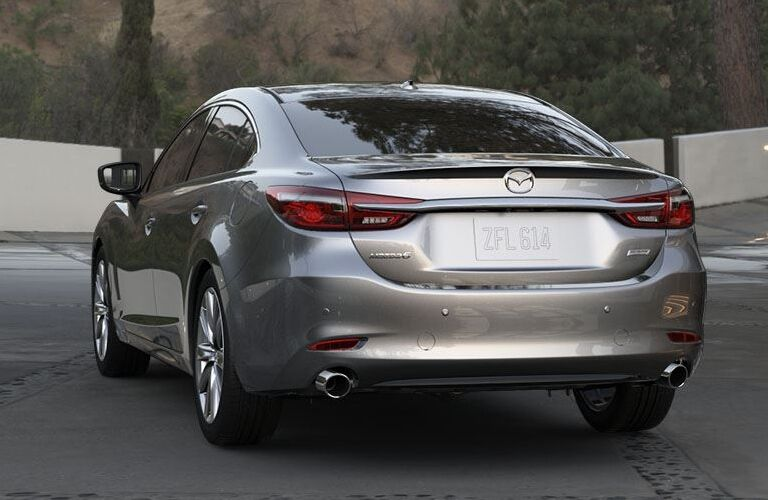 Exterior view of a silver 2018 Mazda6 parked in a long driveway