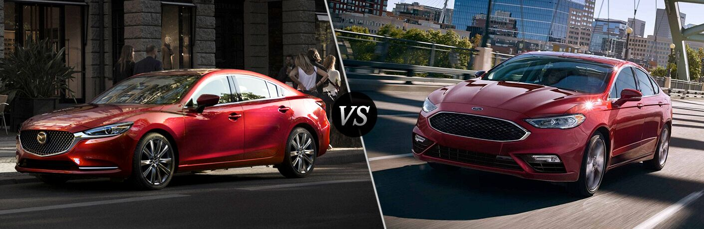 Red 2018 Mazda6 parked on city street compared to Red 2018 Ford Fusion driving down city street