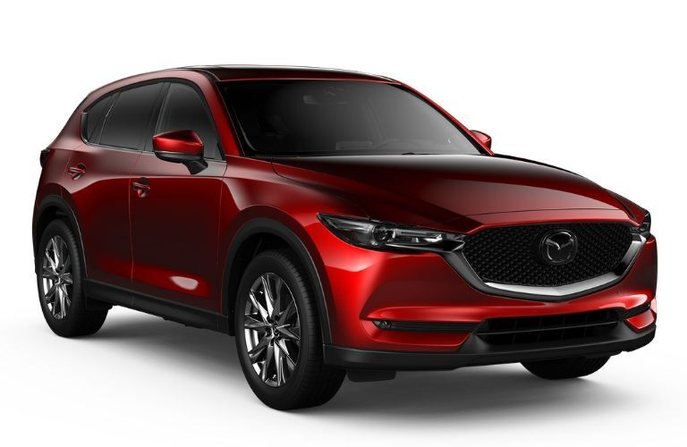 Exterior view of the front of a red 2019 Mazda CX-5 Signature Diesel