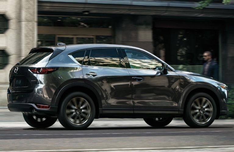 Exterior view of the passenger's side of a gray 2019 Mazda CX-5 Signature Diesel