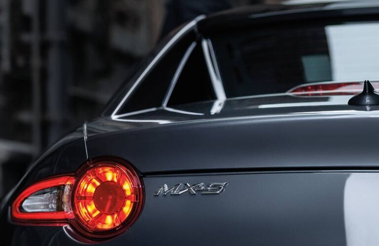 Exterior closeup view of the taillights and MX-5 badge on a gray 2019 Mazda MX-5 Miata RF