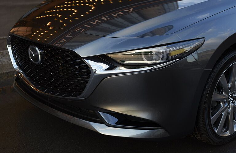 Exterior closeup view of the front of a gray 2019 Mazda3 Sedan