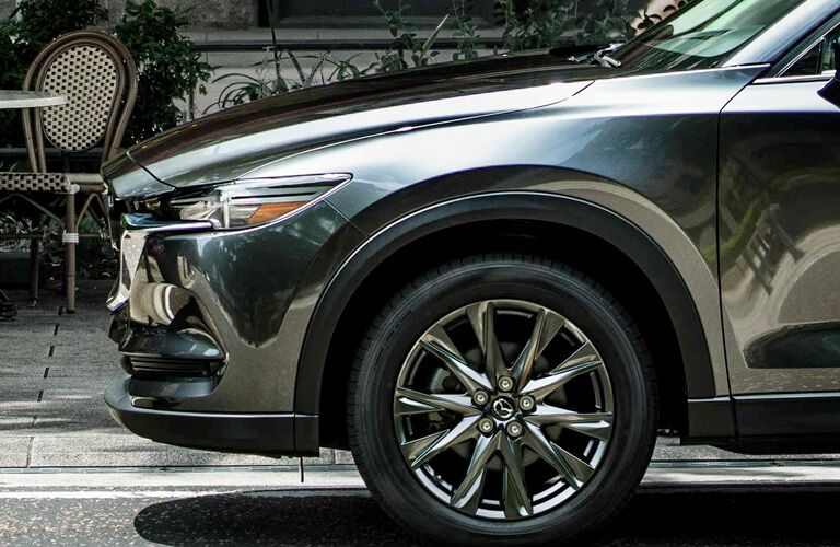 Closeup view of the front driver's side wheel on a gray 2019 Mazda CX-5