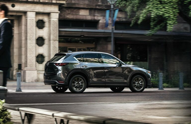 2020 Mazda CX-5 black paint exterior shot parked on side of city street showing passenger side doors