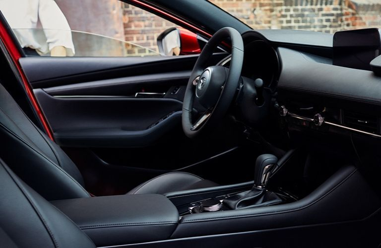 Interior view of the front seating area inside a 2020 Mazda3 Hatchback