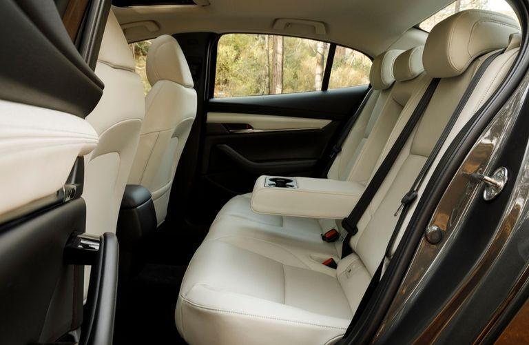 Interior view of the rear seating area inside a 2020 Mazda3 Sedan