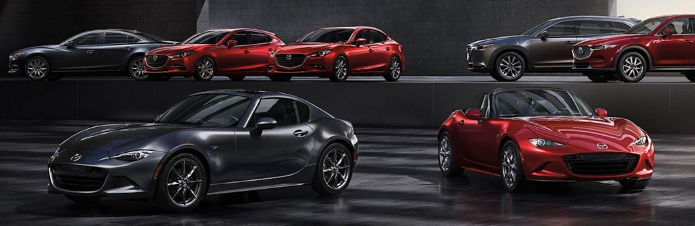 Image of the 2019 Mazda vehicle lineup in a showroom